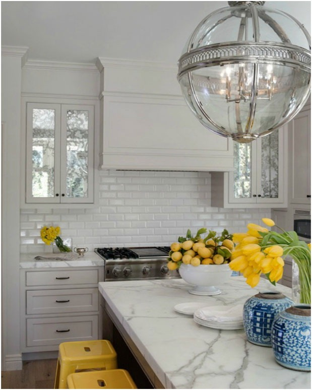 apthecary-kitchen-marble-island-carrera-light-fixture-yellow-stools
