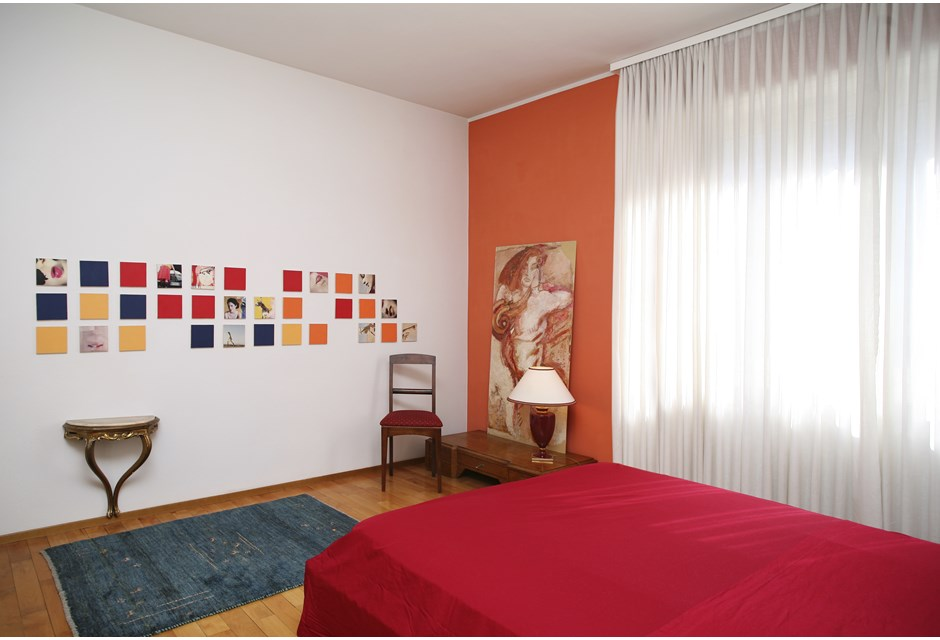 Try an orange accent wall in the bedroom to brighten up the overall