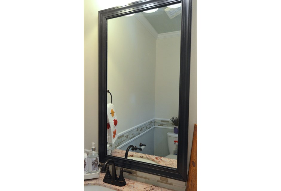 update an outdated clip bathroom mirror with its own wooden frame