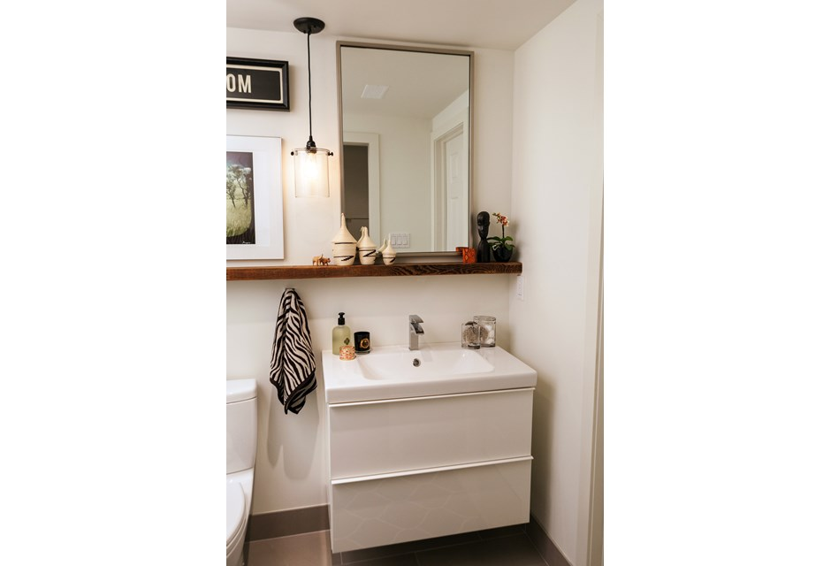 With the stark white modern vanity created for a basement bathroom