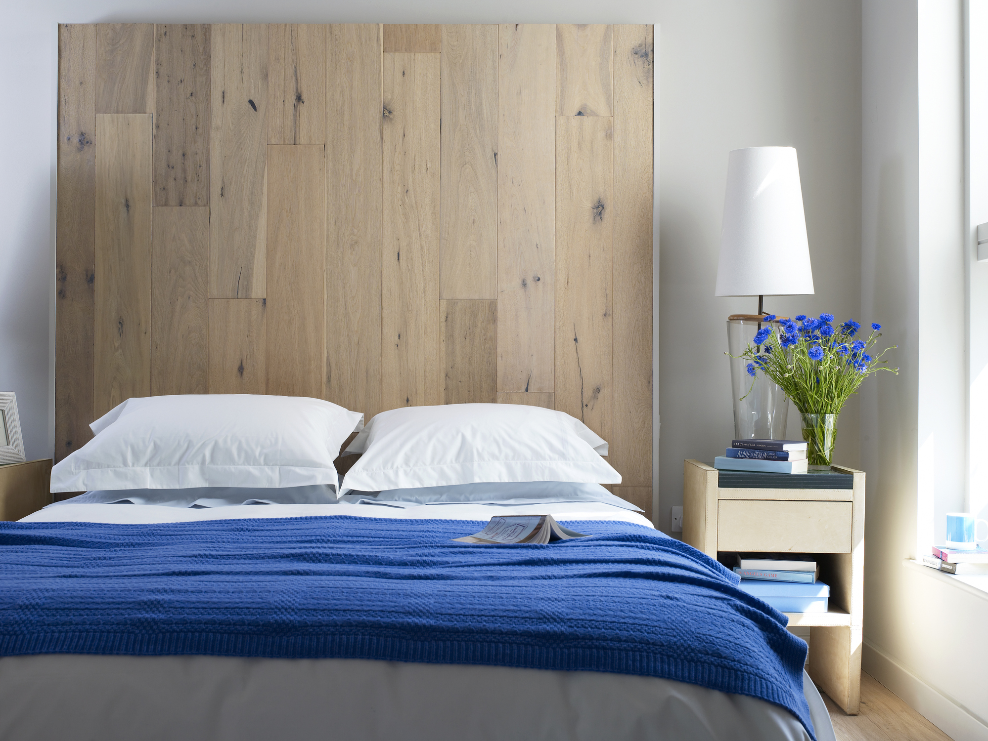 Select a Statement Headboard. 12 Tricks to Make a Tiny Bedroom Look Bigger