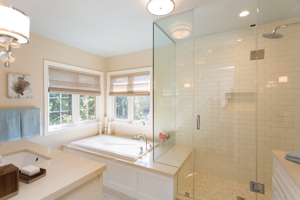 White bathroom with sunken tub and standing shower