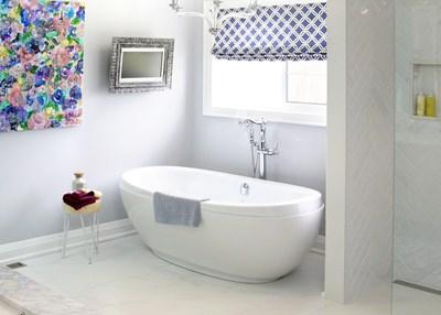 Soaker tub under window in spa bathroom
