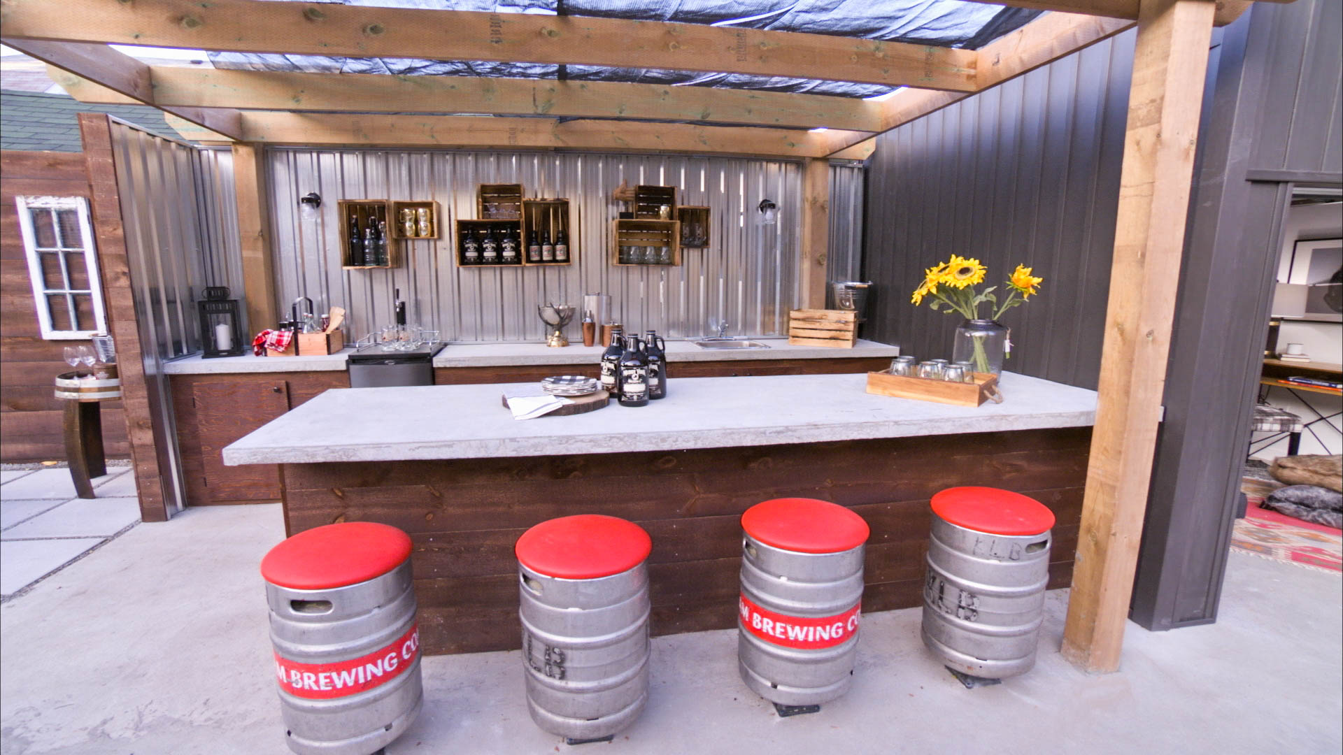 couple living with in laws build backyard sports bar to hide in
