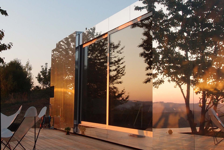 Blink and You'll Miss These Mirror-Clad Prefab Homes