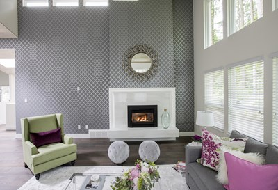 High-shine glass and white, marble-like porcelain tiles are showcased in this sleek gas fireplace.