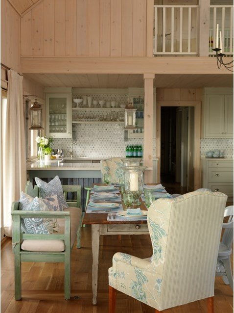 Vintage green bench and wingback chairs at farm table in cottage with aqua color scheme by #SarahRichardson #cottagestyle #whitewashed