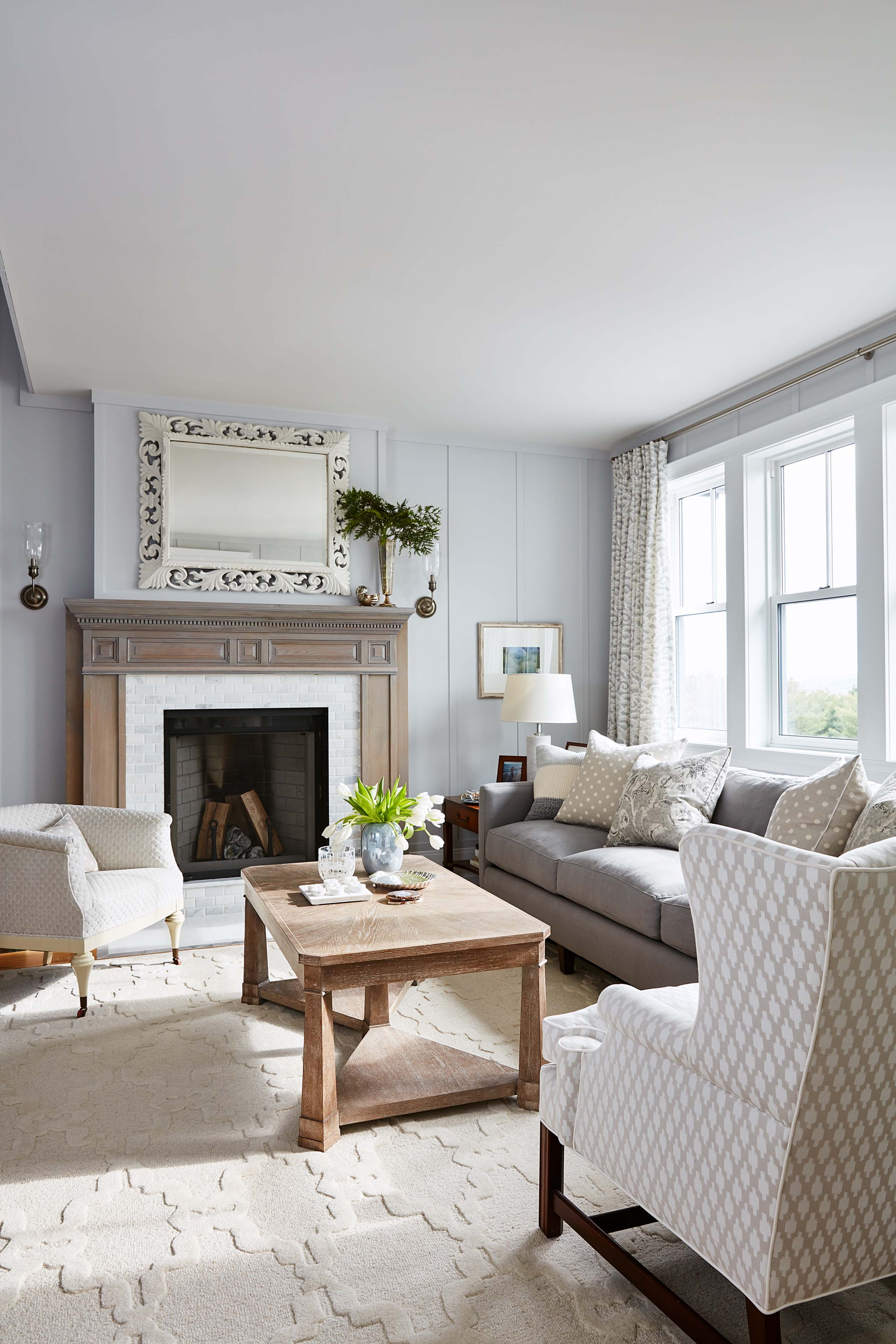 Serene paneled sitting room with fireplace and soothing palette in Sarah Richardson's master suite