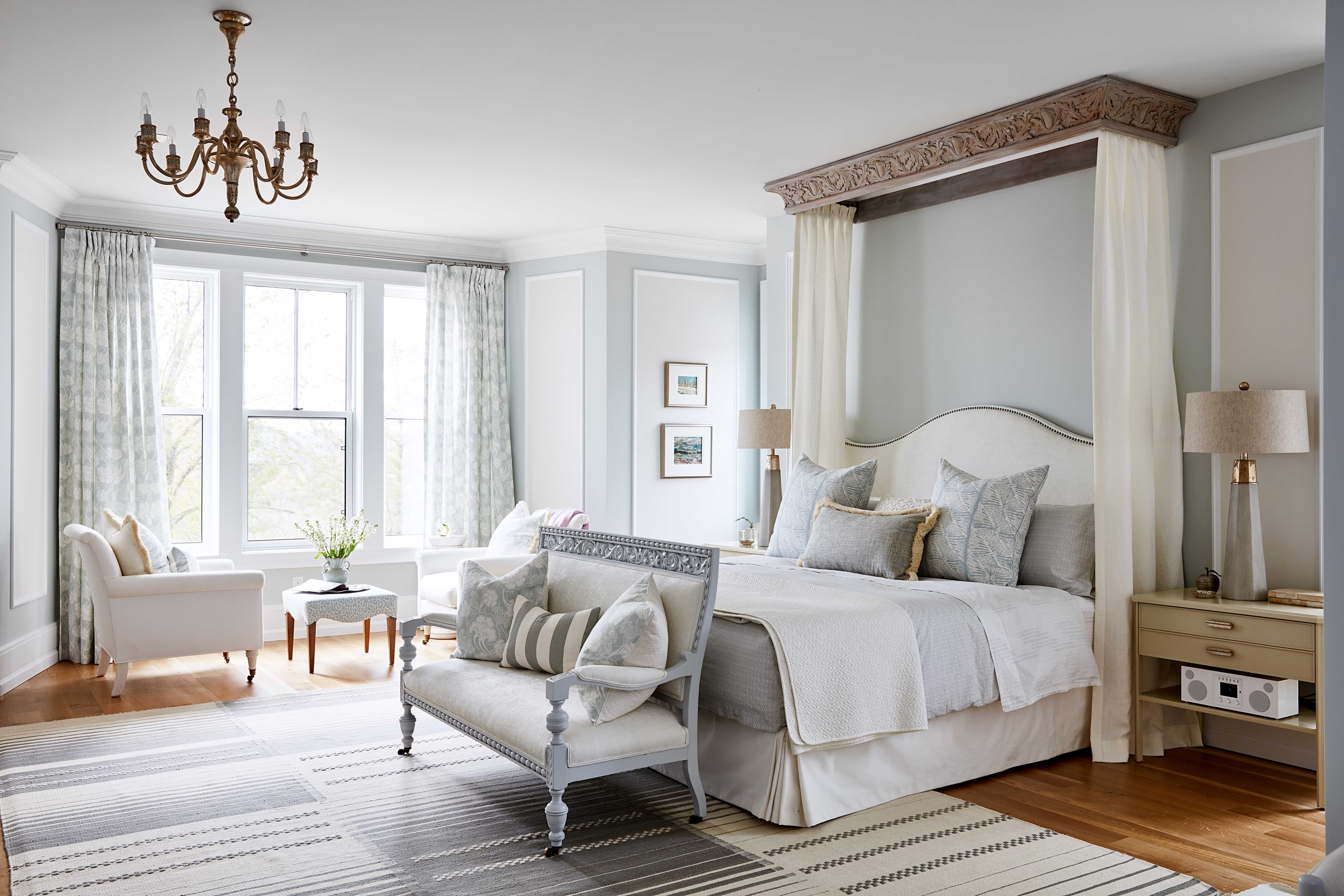 Elegant master suite in Sarah Richardson off the grid house with blue grey palette and ceiling canopy on bed