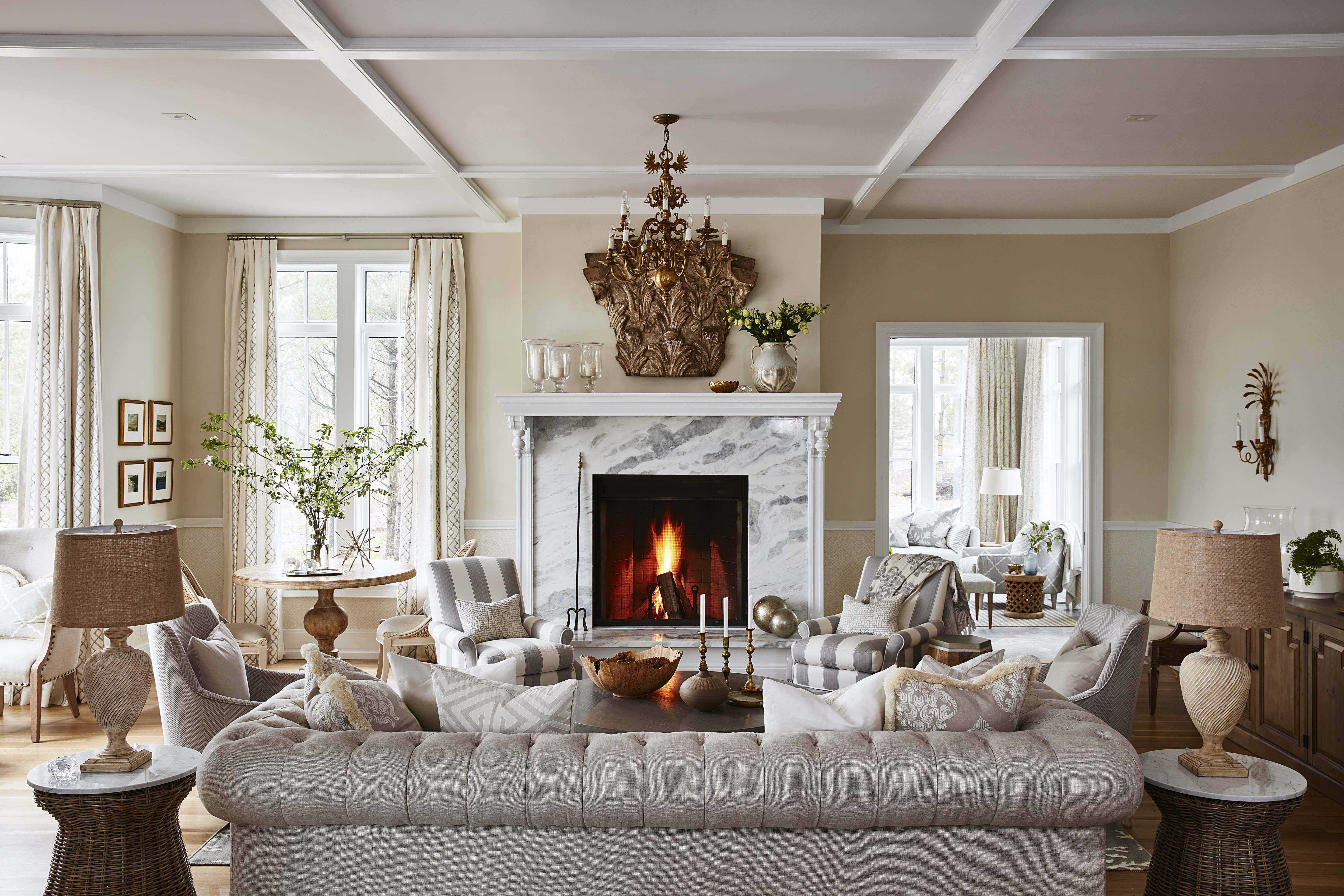 A show-stopping marble fireplace, neutral furniture and lots of textured fabrics create the luxurious look of this living room. #SarahRichardson #moderncountry