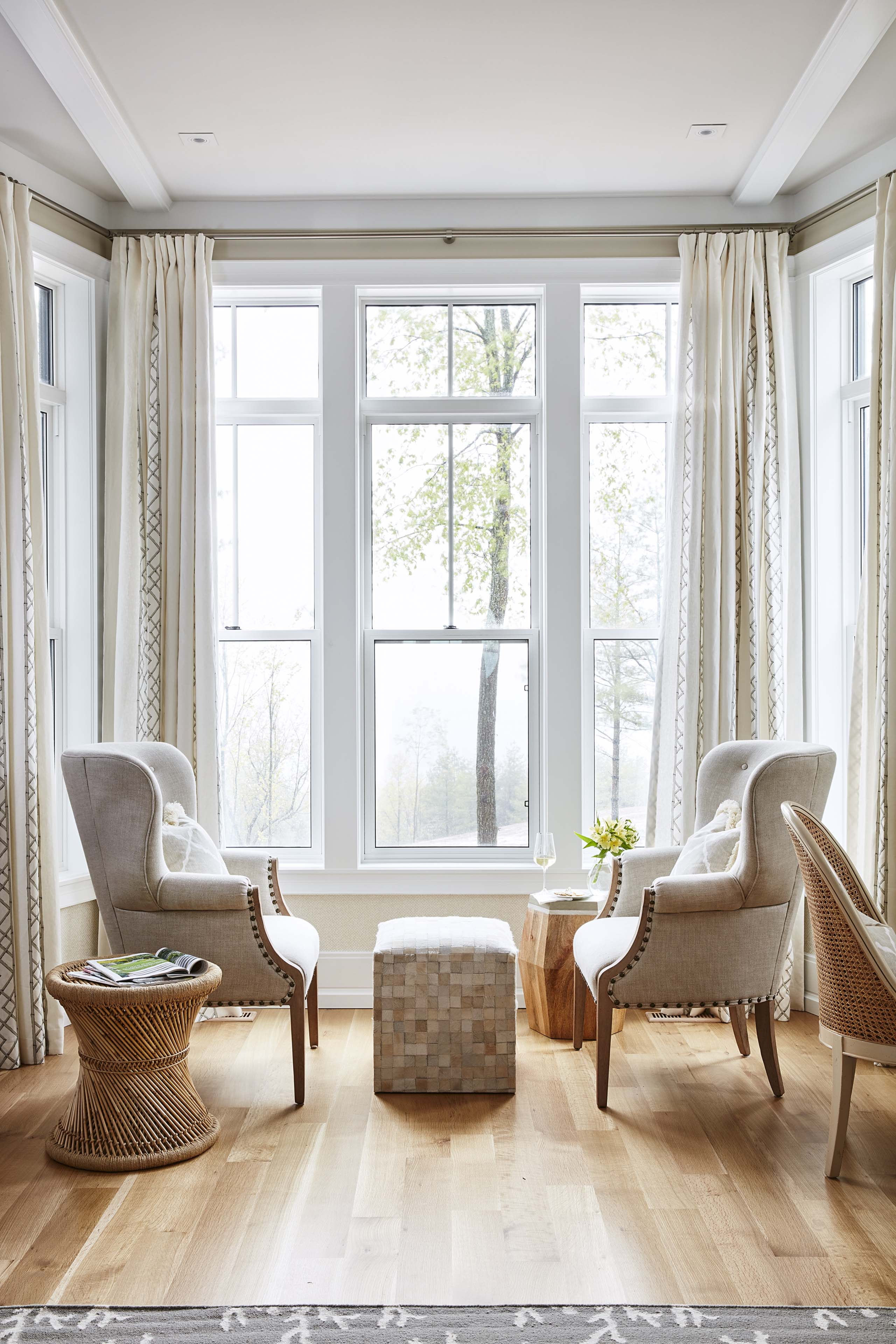 Large bay windows allow lots of natural light in this nook with wing chairs. #SarahRichardson #wingchairs