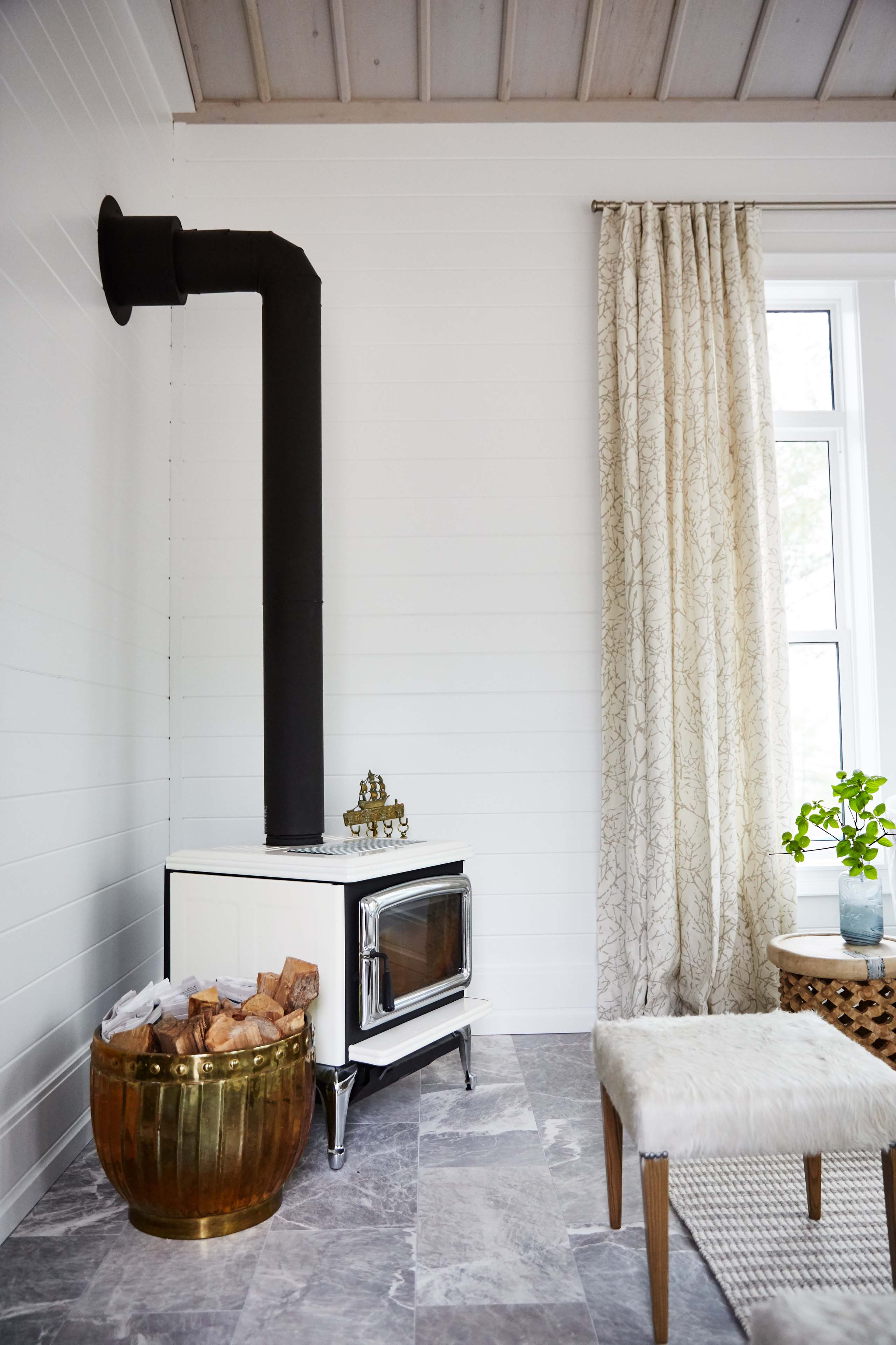 A vintage fireplace stove adds instant charm and character. #SarahRicardson #woodburningstove