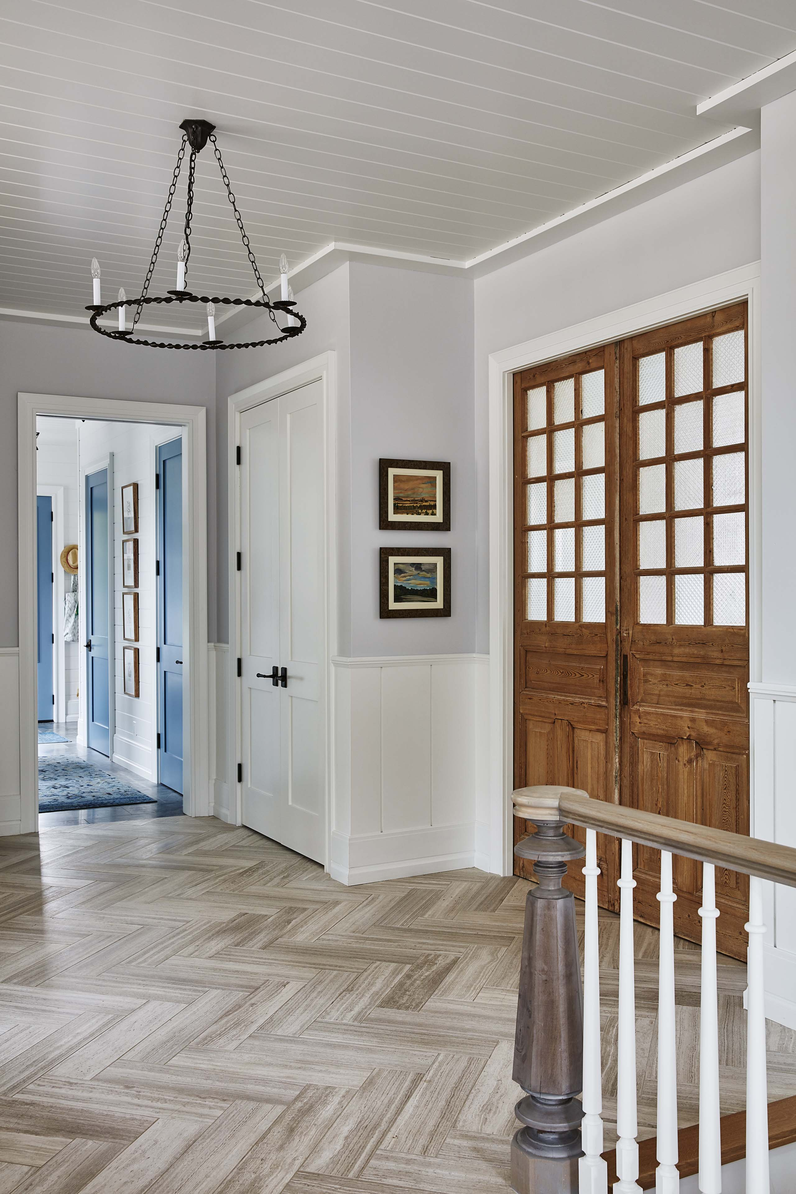 Beautiful frosted french doors in a modern farmhouse foyer. #bluedoor #Sarah Richardson #herringbonefloor