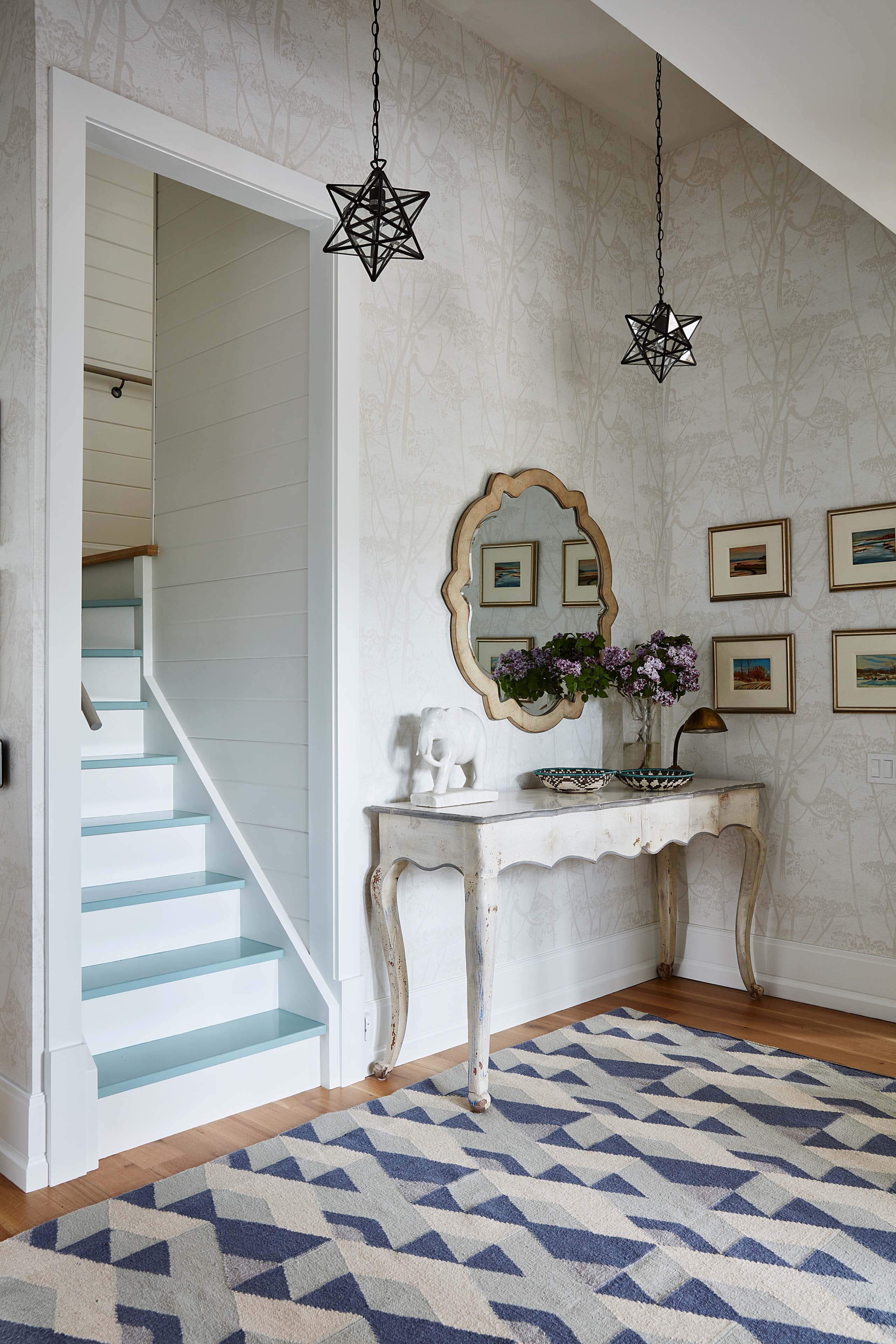 Eclectic entry in Sarah Richardson's Ontario home. #starpendant #SarahRichardson #blueandwhitedecor