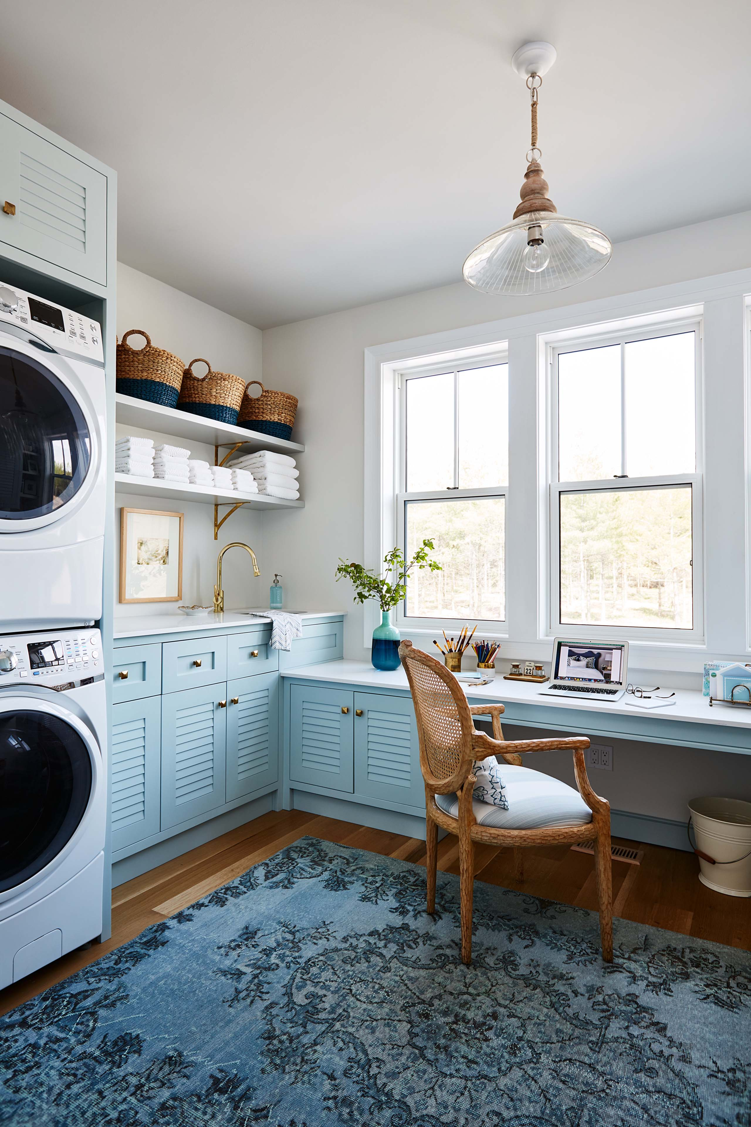 Blue and white laundry room by #SarahRicharson. #louveredcabinet #plantationcabinets