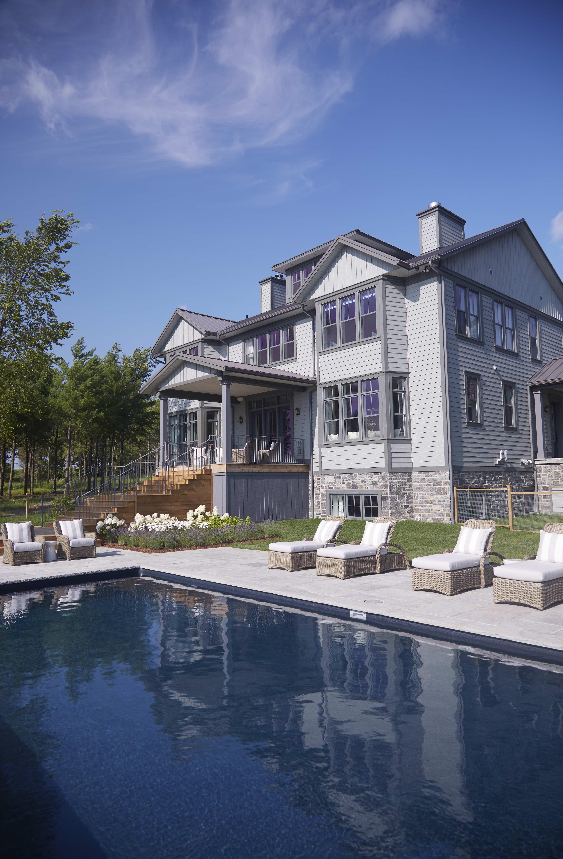 Exterior and pool of Sarah Richardson off the grid modern farmhouse in Ontario. #SarahRichardson
