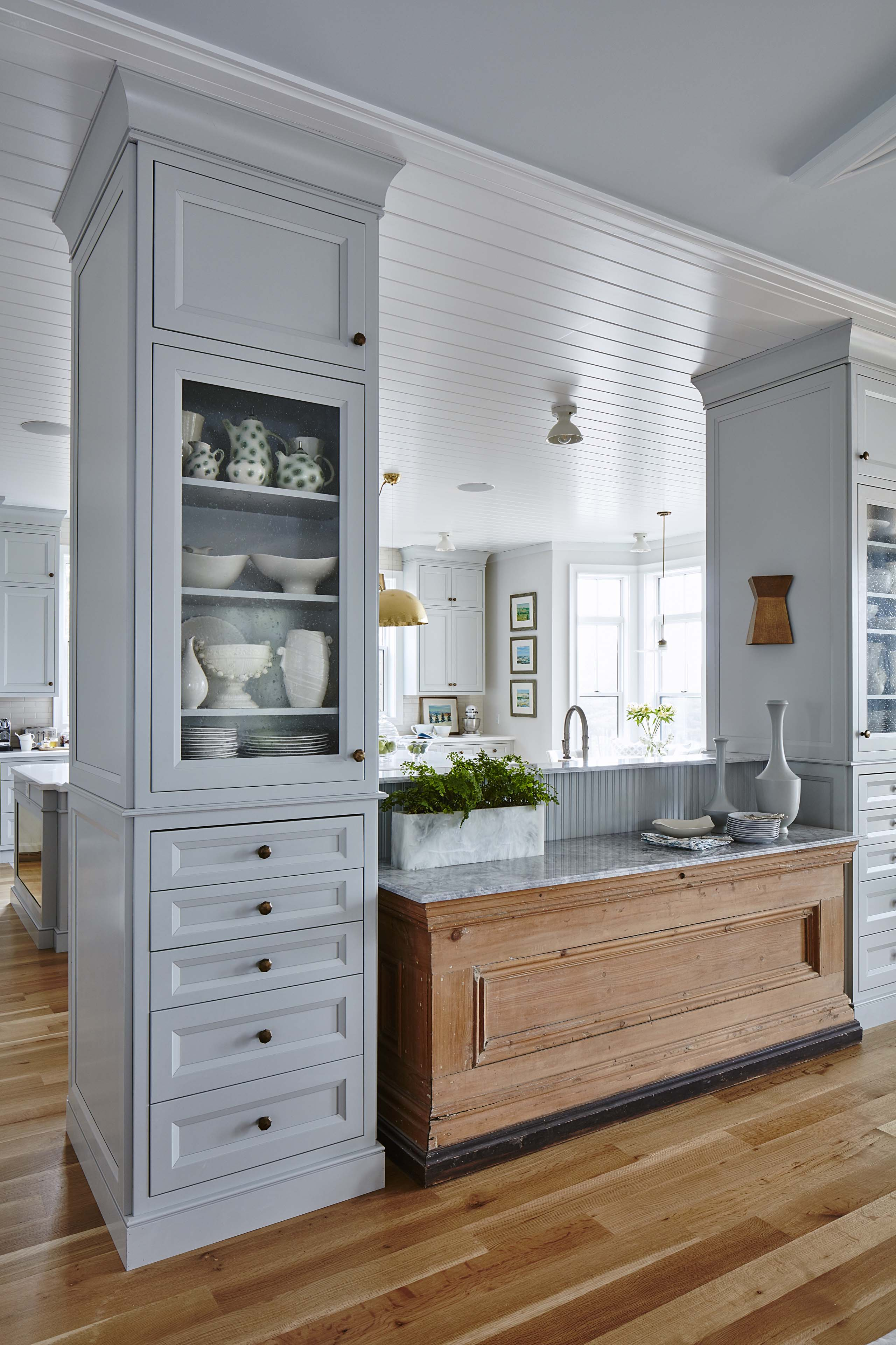 Grey and white modern farmhouse kitchen with built-in cabinets and beadboard ceiling. #SarahRichardson #modernfarmhouse #farmhousekitchen #moderncountry